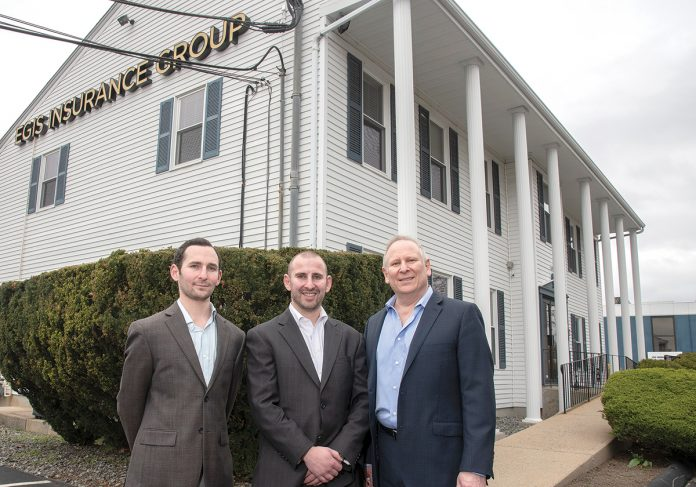 ROOM TO GROW: The Egis Group recently relocated from Providence to its own building in Warwick, and is expanding. From left, Corey Finkelman, director of marketing; Alex Finkelman, vice president; and Roy Finkelman, president.