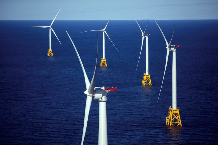 A FRESH BREEZE: With state approval of the power-purchase agreement for the Revolution Wind project, Rhode Island is one step closer to having a utility-scale wind farm to go along with the Block Island Wind Farm pictured above. / BLOOMBERG NEWS FILE PHOTO/ERIC THAYER