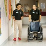 SMOOTH RIDE: Elijah Matthews, left, and Xavier Rivera work in central transport at Rhode Island Hospital in 2018. The job, often filled in the summer by interns, involves moving patients and equipment.