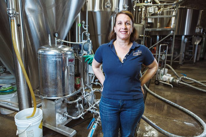 SPIRITED CULTURE: Jennifer Brinton, co-owner of Grey Sail Brewing of Rhode Island, strives to maintain a family atmosphere and culture at the brewery.