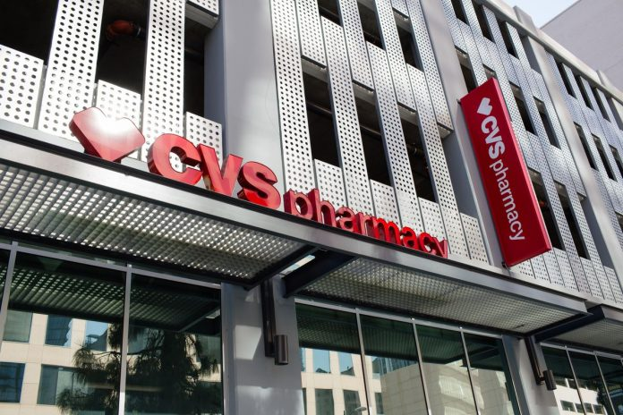 THE MERGING OF CVS Health and Aetna grew net income for the combined company by 43% year over year in the first quarter to $1.4 billion. / BLOOMBERG NEWS FILE PHOTO/CHRISTOPHER LEE