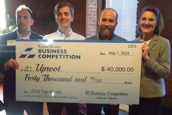 "UPROOT was named the overall winner of the 2019 Rhode Island Business Competition. Above, from left to right:, Anthony Mangiarelli, competition co-chair; Kevin Eve and Jacob Conway, both of Uproot, and Margaret ""Peggy"" Farrell, competition co-chair. / COURTESY RHODE ISLAND BUSINESS COMPETITION"