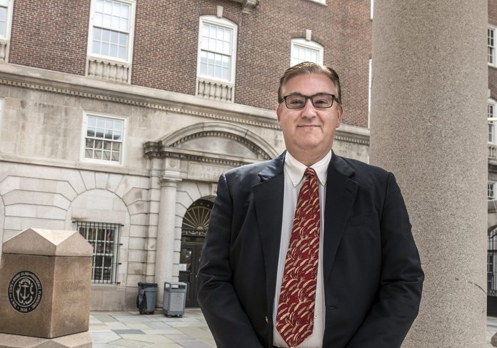 SPORTS BETTING: Attorney Joseph Larisa, founder of Larisa Law in Providence, stands in front of the Superior Court building in Providence. Larisa is representing Dr. Daniel S. Harrop, a Providence psychiatrist who has filed a lawsuit in state Superior Court seeking to overturn state approval of sports betting unless it is approved by voters.