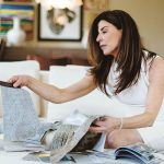 DECISIONS, DECISIONS: Mary Jean Keany, owner of Anamika Design in Newport, looks through swatches for an interior design project.  / PBN PHOTO/RUPERT WHITELEY