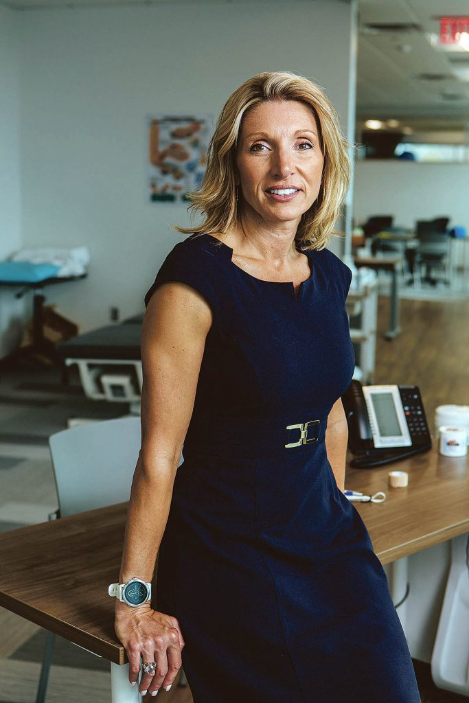 above and beyond: Kathleen Snelgrove, chief operating officer at University Orthopedics, spent years overseeing the planning and building of a 90,000-square-foot location in East Providence. The building overlooking the Providence River was completed last spring. / PBN PHOTO/RUPERT WHITELEY