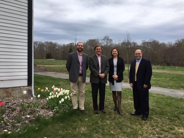 REPRESENTATIVES OF BAYCOAST BANK and the Westport Land Conservation Trust at the former St. Vincent de Paul Camp. From left, Ross Moran, executive director of the Westport Land Conservation Trust; Trip Millikin, WLCT board president; Betty-Ann Mullins, BayCoast Bank senior vice president; and Richard De Almeida, BayCoast Bank vice president and loan officer./ COURTESY BAYCOAST BANK