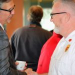 KEITH HOVAN, CEO of Southcoast Health shakes hands with Kevin Gallagher, fire chief for the town of Acushnet, at the Southcoast Health annual EMS provider breakfast. / COURTESY SOUTHCOAST HEALTH