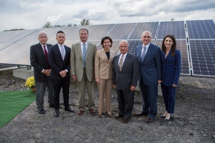 SOUTHERN SKY RENEWABLE ENERGY RHODE ISLAND has been sued by Southern Sky Renewable Energy in federal court. From left, North Providence Chief of Staff Richard Fossa; North Providence Town Council President Dino Autiello; Senate President Dominick J. Ruggerio; Gov. Gina M. Raimondo; North Providence Mayor Charles Lombardi; Southern Sky President Ralph A. Palumbo and Southern Sky Vice President Lindsay McGovern in front of a Southern Sky Renewable Energy Rhode Island solar array in North Providence in October. / COURTESY SOUTHERN SKY RENEWABLE ENERGY RHODE ISLAND