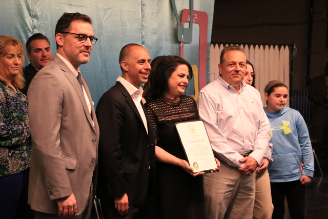 ELIZABETH AMADIO, a sixth-grade teacher at Gilbert Stuart Middle School, was named the 2019 Providence Public Schools District Teacher of the Year. Above, from left, Tom Flanagan, chief academic office for PPSD, Providence Mayor Jorge O. Elorza, Elizabeth Amadio and Amadio's husband Johm. / COURTESY CITY OF PROVIDENCE