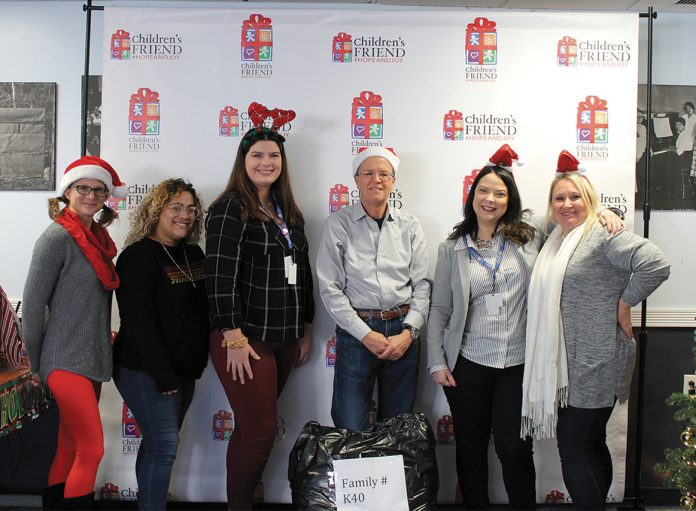 MISSION-DRIVEN: Children's Friend staff takes part in initiatives such as a holiday drive that provides clothing and toys to vulnerable families. / COURTESY CHILDREN'S FRIEND