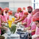 DOING THEIR PART: Collette employees participate in a meal-packaging event in partnership with Rise Against Hunger last July. / COURTESY COLLETTE