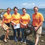 PRETTY NEAT: Amica employees use their annual volunteer day to work with Clean Ocean Access to clear debris from the local shoreline. / COURTESY AMICA MUTUAL INSURANCE