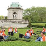 LOOKING SPIFFY: Embrace employees volunteer to beautify Newport Preservation Society properties ahead of the tourism season. / COURTESY EMBRACE HOME LOANS