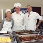 SWITCHING UP: From left, attorneys Robin L. Main, Todd M. Gleason and David J. Rubin serve food on Administrative Professionals Appreciation Day. / COURTESY HINCKLEY, ALLEN & SNYDER