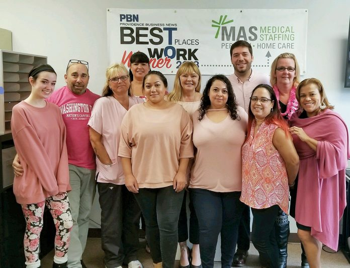MEETING THEIR MATCH: Staff members at MAS Medical Staffing dress in pink as part of Breast Cancer Awareness Month in October. / COURTESY MAS MEDICAL STAFFING