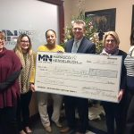 CHECK IT OUT: Staff members at Marasco & Nesselbush donate $1,500 to the Alzheimer's Association, Rhode Island chapter. / COURTESY MARASCO & NESSELBUSH