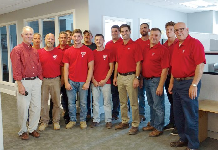 MATCH DAY: Members of the Pariseault Builders staff at the company headquarters in Warwick. 
