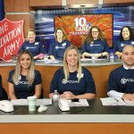AT THE READY: A team of Pawtucket Credit Union employees staffs the phones during a Salvation Army and WJAR-TV NBC 10 fundraiser on Thanksgiving.