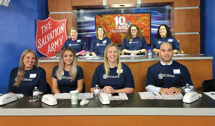 AT THE READY: A team of Pawtucket Credit Union employees staffs the phones during a Salvation Army and WJAR-TV NBC 10 fundraiser on Thanksgiving. / COURTESY PAWTUCKET CREDIT UNION