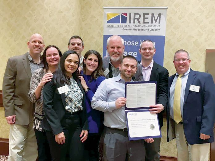 HAPPY BUNCH: Peregrine employees proudly display the Accredited Management Organization designation they earned in December. / COURTESY PEREGRINE PROPERTY MANAGEMENT