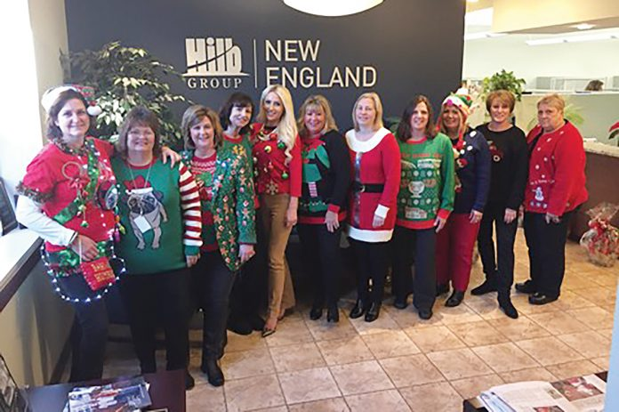 MODEL EMPLOYEES: Staff members at The Hilb Group of New England show off their gaudy holiday sweaters. / COURTESY THE HILB GROUP OF NEW ENGLAND