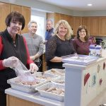 KITCHEN HELP: Providence Mutual employees volunteer to cook dinners for families at the Ronald McDonald House in Providence.