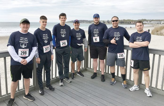 "IN THE RUNNING: Compass IT workers participate in the R.I. State Police's ""5K Foot Pursuit"" in April.