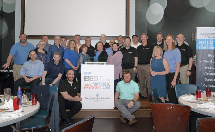 HAPPY OCCASION: Employees at Custom Computer Specialists mark the company being named one of the 2019 PBN Best Places To Work. / COURTESY CUSTOM COMPUTER SPECIALISTS