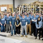 GROUP GATHERING: The staff of Sweenor Builders at the company workshop in the Wakefield section of South Kingstown.