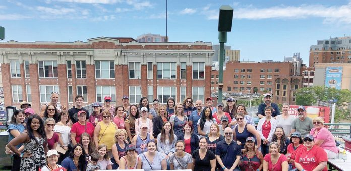 OUT TO THE BALLGAME: Healthcentric staff members gather for a barbeque and a Red Sox game at Fenway Park in 2018. / COURTESY HEALTHCENTRIC ADVISORS