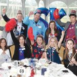TRUE COLORS: Sansiveri, Kimball & Co. employees show their team spirit at the 2018 PBN Best Places To Work event.  / COURTESY SANSIVERI, KIMBALL & CO.
