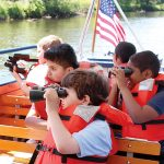 SEEING SIGHTS: Children enjoy the RiverClassroom on the Blackstone River, a program supported by the Narragansett Bay Commission.