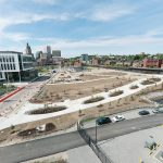 SLOW BUT SURE: The Wexford Science & Technology innovation center, left, and the public park, center, being built on the former I-195 land in Providence, are early pieces of the creation of a new neighborhood in the heart of Providence.
