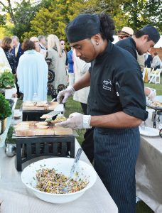 FLOWER SHOW: A chef from Russell Morin Catering & Events prepares hors d'oeuvres for the Preview Party at the Newport Flower Show, which will be held at Rosecliff from June 21-23.