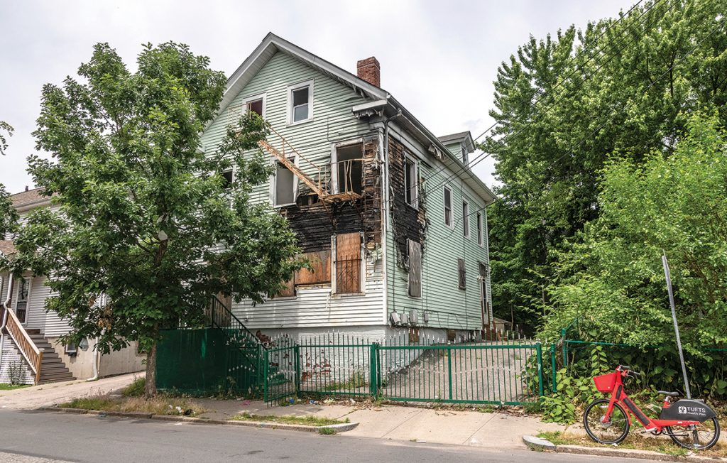 ABANDONED PROPERTY: Anderson Bonilla, who lives across the street from an abandoned house, shown here, at 47 Superior St. in the West End of Providence, said people have broken into the house to use drugs there. / PBN PHOTO/MICHAEL SALERNO