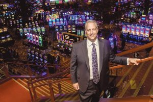 EXPANDED ROLE: Marc Crisafulli, executive vice president of Twin River Worldwide Holdings, was named president of the company's Rhode Island operations, including Twin River Casino Hotel and Tiverton Casino Hotel, earlier this month. He is pictured at Twin River Casino Hotel in Lincoln. / PBN PHOTO/MICHAEL SALERNO