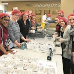 A BIG HELPING: Employees of Becton, Dickinson and Co. in Warwick help package 25,000 meal packets in support of Rise Against Hunger.x / Lists: Best Places to Work - Enterprise