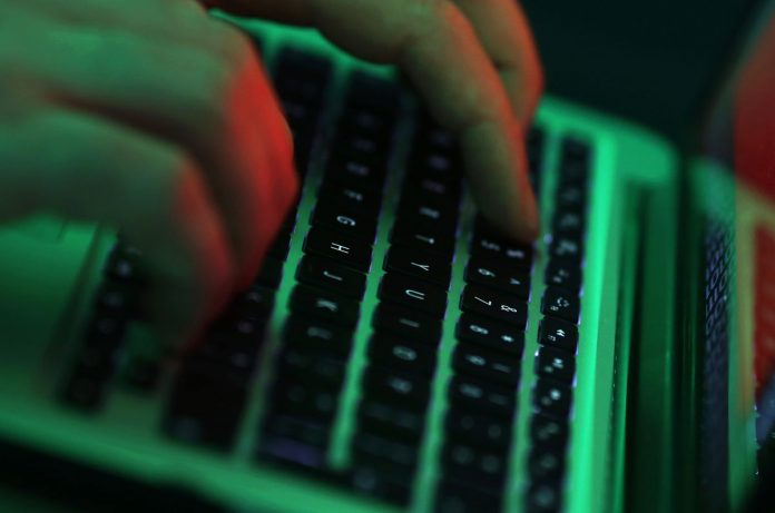 ORGANIZED CRIME groups are selling access to the computer networks of financial firms like Bank of America Corp. and hacking tools targeting these companies, according to a British researcher who posed as a buyer on several dark web marketplaces. / BLOOMBERG FILE PHOTO/CHRIS RATCLIFFE