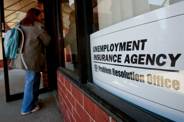 US. JOBLESS claims fell to 216,000 last week . / BLOOMBERG NEWS FILE PHOTO/JEFF KOWALSKY
