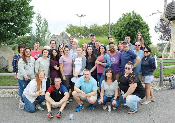 IN GOOD COMPANY: BSMG employees gather for an annual outing at Mulligan's Island in Cranston in 2018. / COURTESY BROKERS' SERVICE MARKETING GROUP