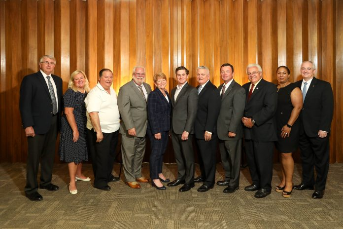 THE SOUTHCOAST and Bristol County chambers of commerce have voted to merge into a yet-to-be-named nonprofit entity. Above, members of the integration task force. From left: Bill Perkins; Catherine Dillon; Douglas Rodrigues; Rick Kidder, CEO of the SouthCoast Chamber; Kim Perry; Brian LeComte; Michael O'Sullivan, CEO of the Bristol County Chamber; Curt Nelson; Carl Sawejko; Rose Lopes; and Ron Ellis. / COURTESY SOUTHCOAST CHAMBER OF COMMERCE AND BRISTOL COUNTY CHAMBER OF COMMERCE