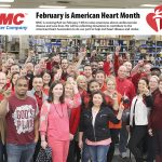 PUMPED: Employees at National Marker wear red after collecting donations for the American Heart Association in February.