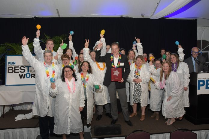 AMGEN RHODE ISLAND employees celebrating palcing No. 1 in the 2019 Best Places To Work competition among enterprise companies. / PBN PHOTO/ MIKE SKORSI