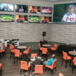 BETTORS LOST $6.9 million in fiscal 2019 on sports wagering in Rhode Island. Above, guests watch games in the lounge at the sportsbook at the Twin River Casino Hotel in Lincoln. / PBN FILE PHOTO/MICHAEL SALERNO