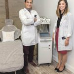 COSMETIC MEDICINE: Anti-Aging & Laser Institute opened in Providence in February. Owner and Chief Medical Officer Dr. Irving Restituyo is pictured with Executive Director Cindy Lang. / PBN PHOTO/MICHAEL SALERNO