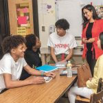 BIG STEP: Marcy Reyes, with some of her students at Central High School in Providence, where she began her Financial Literacy Youth Initiative program. From left, Osury Aponte, Sita Traore, Daniel Gonzalez, Reyes and Ashley Ortiz. / PBN PHOTO/MICHAEL SALERNO