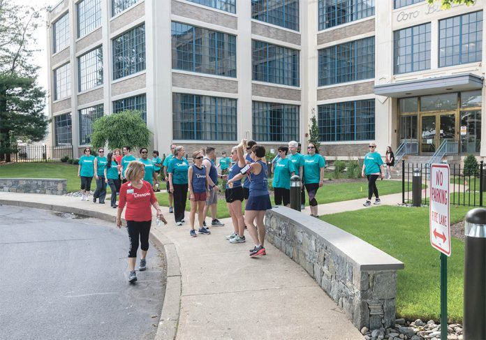 ON-SITE FITNESS: Team Lifespan members participate in one of the company's corporate fitness outings near the offices on Point Street in ­Providence. / PBN PHOTO/MICHAEL SALERNO