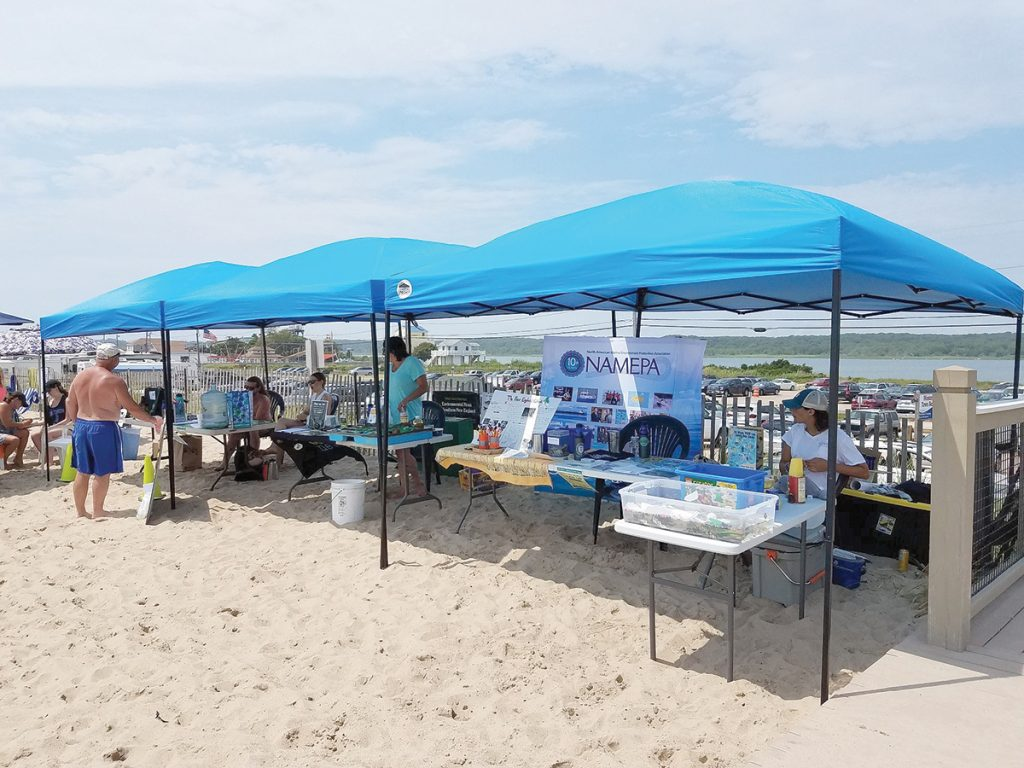 GREEN THE BEACH: Environmental-information displays are set up at Westerly Town Beach during last year's inaugural Green the Beach event. This year's event will be held at the beach on July 20. / COURTESY TOWN OF WESTERLY