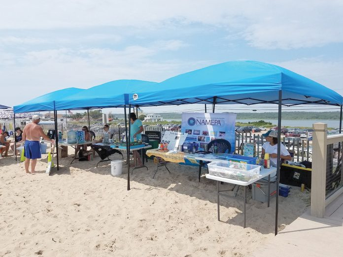 GREEN THE BEACH: Environmental-information displays are set up at Westerly Town Beach during last year's inaugural Green the Beach event. This year's event will be held at the beach on July 20.