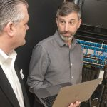 TECH SUPPORT: Terrence Boylan, left, CEO of PacketLogix, specializing in highly responsive information technology support, consulting and managed IT services, works with client Charles Antone, chief operating officer for Building Enclosure Science. / PBN PHOTO/MICHAEL SALERNO